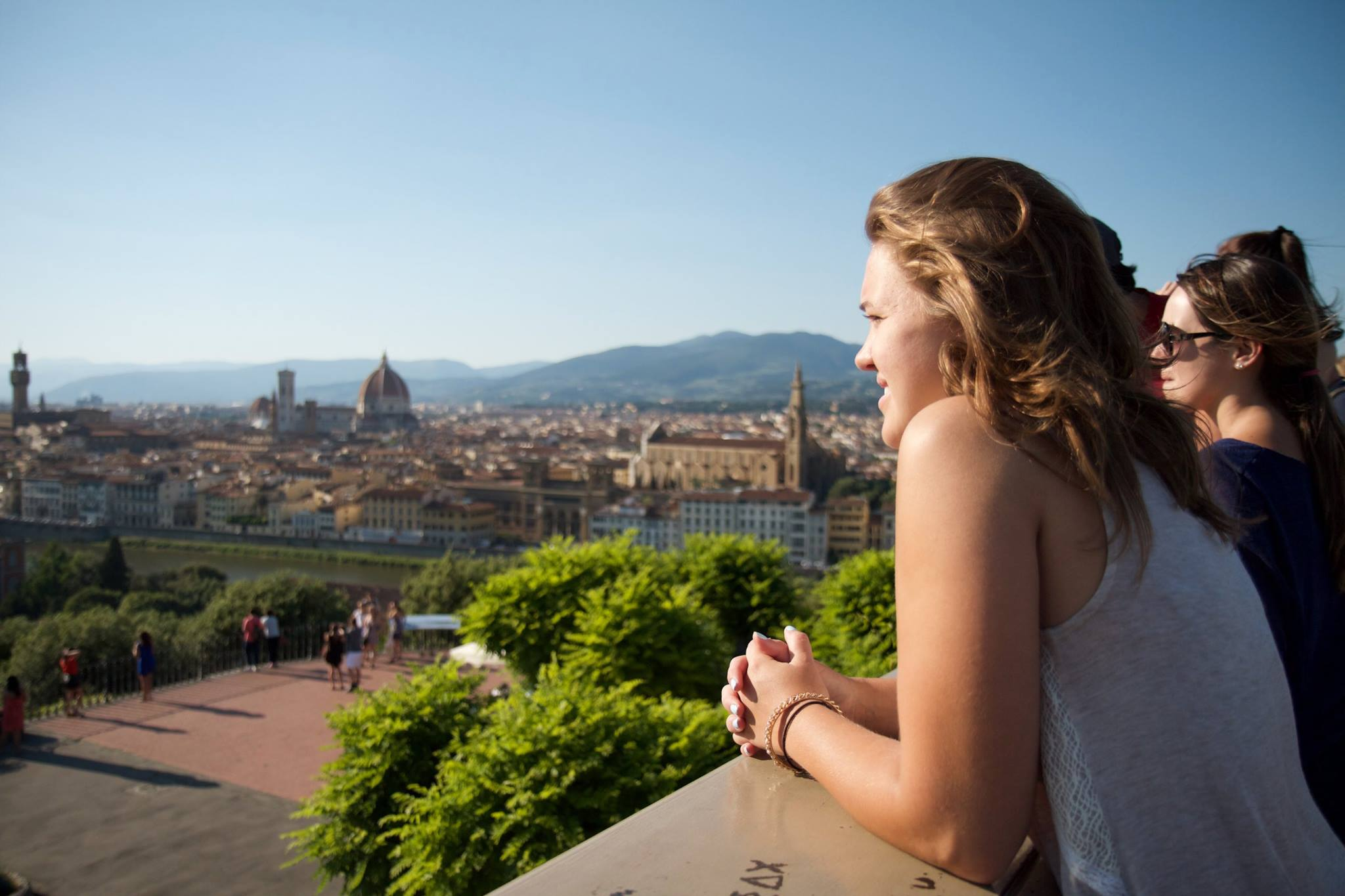 Female student looking over the city at her study abroad.