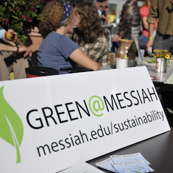 Students holding up a board saying Green at Messiah by Office of Sustainability