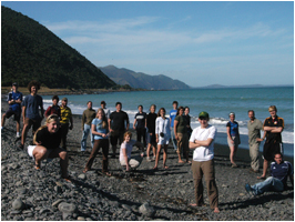 Group on a pebble beach in New Zealand