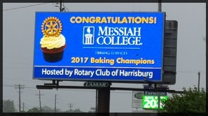 A highway bulletin board congratulating the 2017 baking champions from Messiah College.