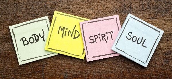"Four sticky notes saying ""Body, Mind, Spirit, Soul."""