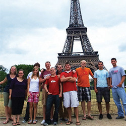 I B I trip students in front of the Eiffel Tower.