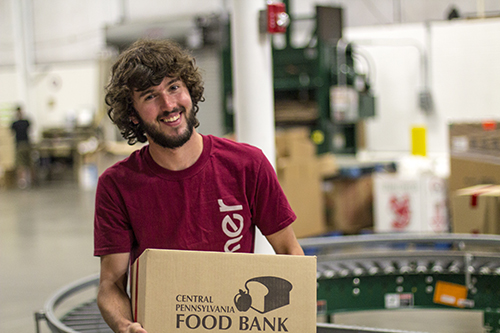 Messiah College student working at a food bank.