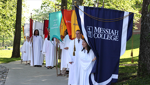 Students carrying department flags during Messiah College's graduation ceremony