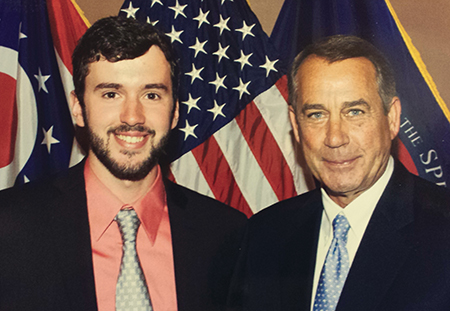 Johnathan Hershey and John Boehner standing in front of the American flag