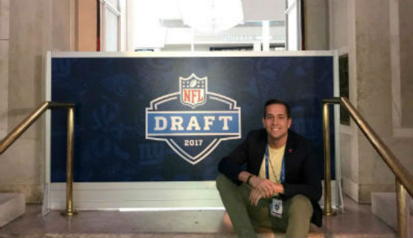 J. Parenti in front of NFL draft sign
