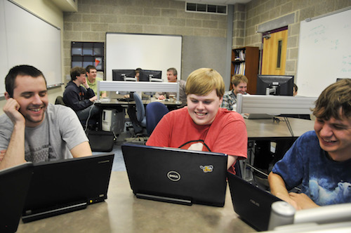 students working on laptops in lab
