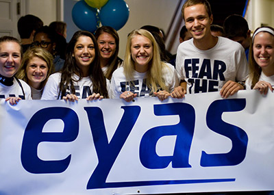 EYAS members holding up the EYAS logo.