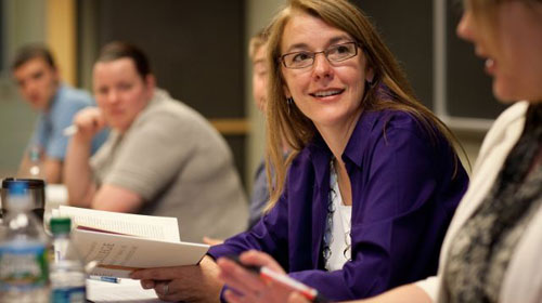 Graduate professor engaging with students