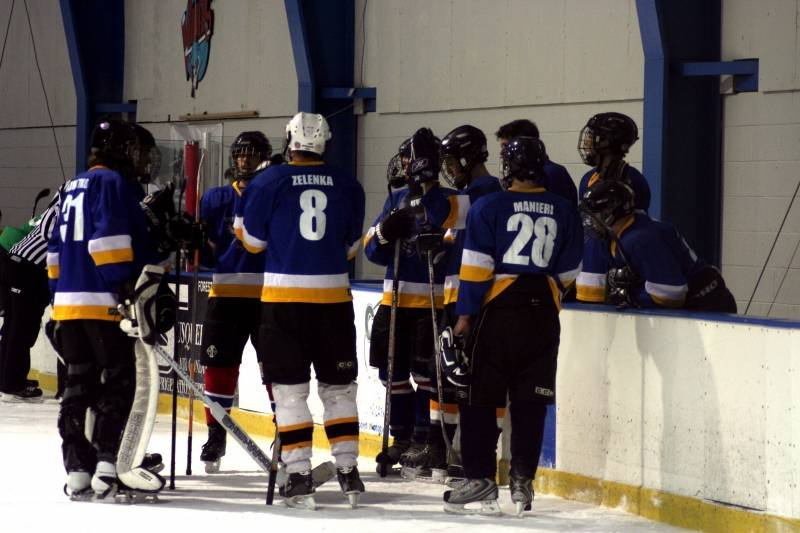Ice Hockey club team gathered around each other