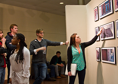 Students watching an art exhibition at the High Center.