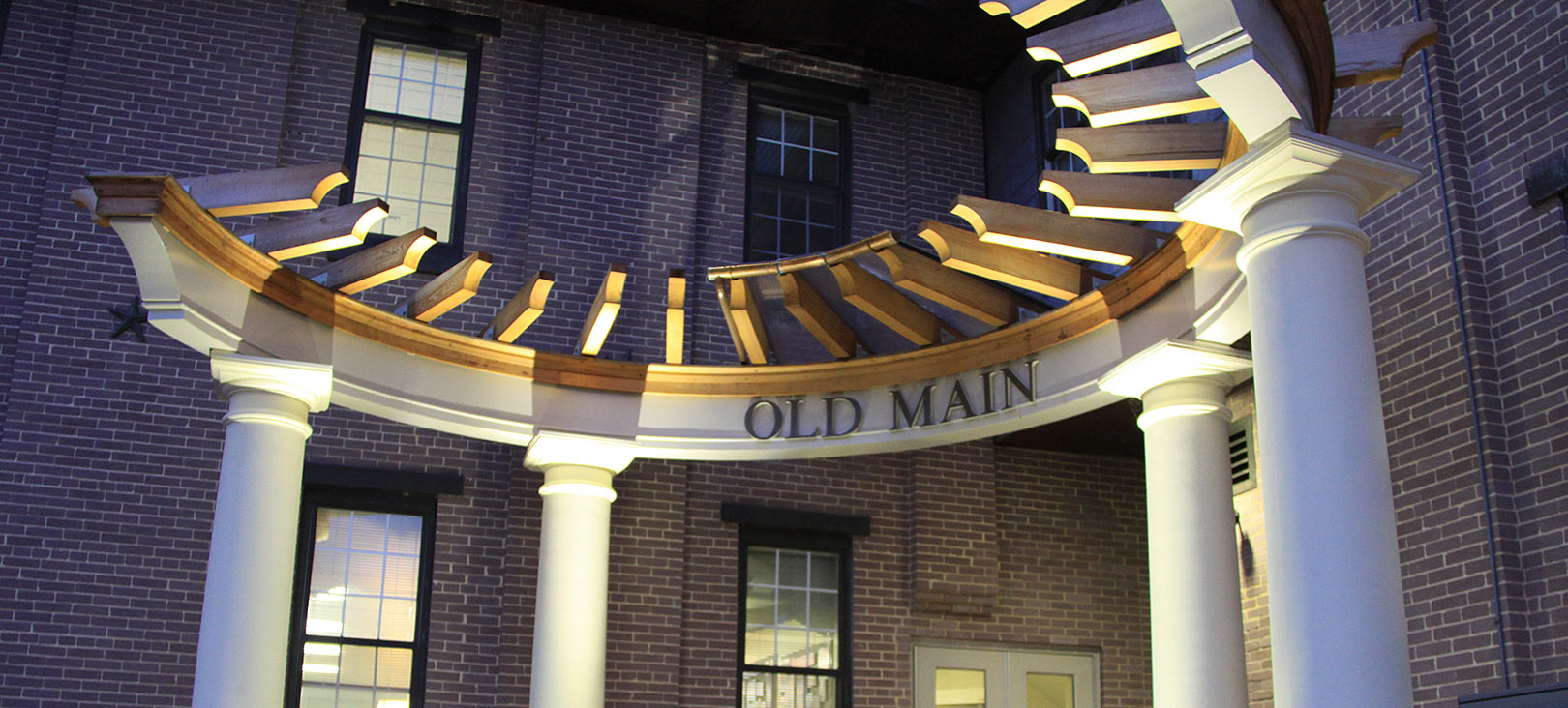 Finance & Planning  The entrance of Old Main Office Building which is lit up at night.jpg
