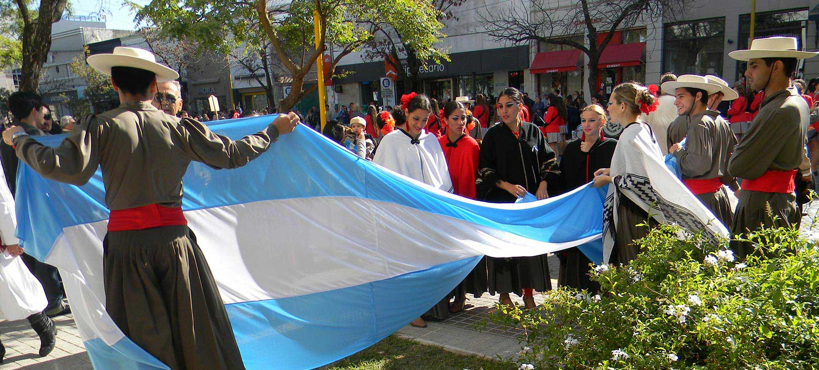 Off-Campus Programs crosscultural parade with flag.jpg